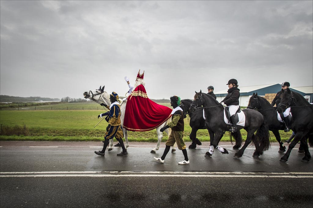 The arrival ride of the Dutch saint Sinterklaas in the small Dutch northern town of Anna Palowna.