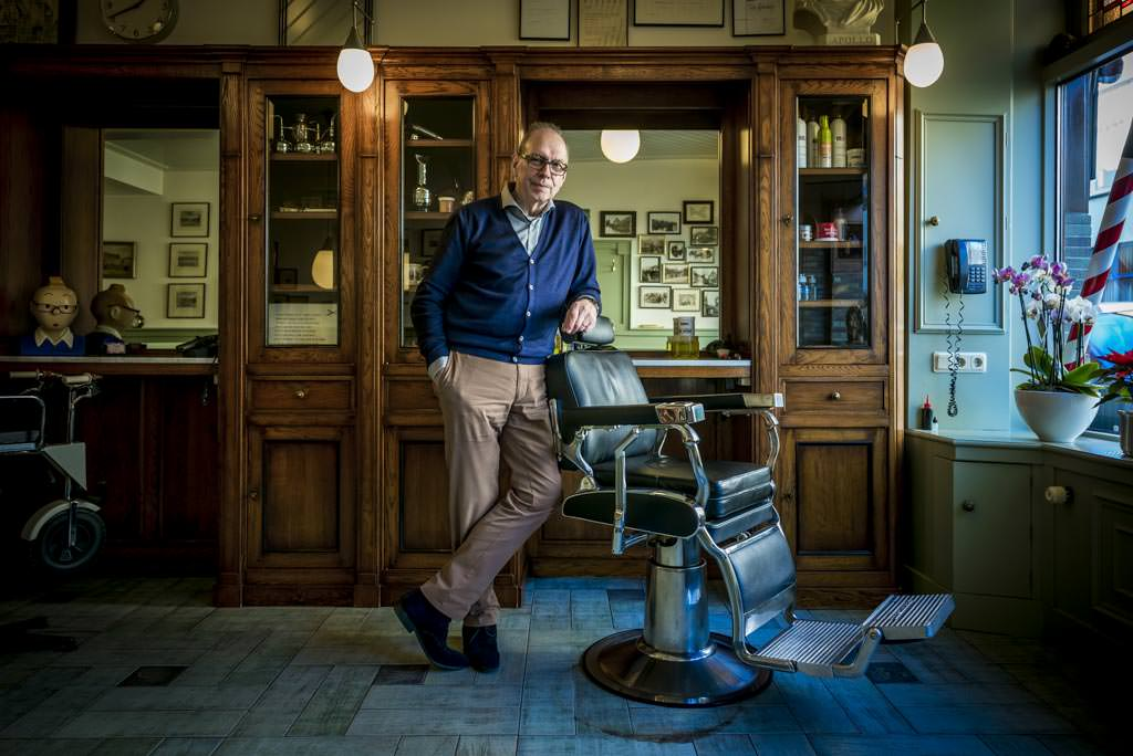 Retired barber Buch in his shop